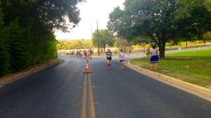 Runners ascend the final hill before darting to the finish at about mile 2 on the course.